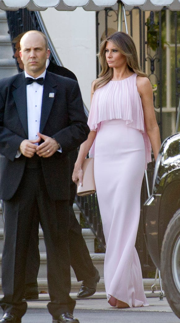 Melania Trump departs the White House to attend the