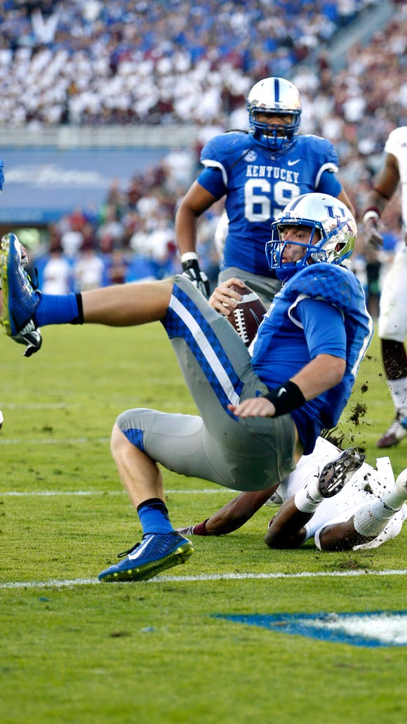 Kentucky's  Patrick Towles earns a touchdown the hard way. Oct. 25, 2014
