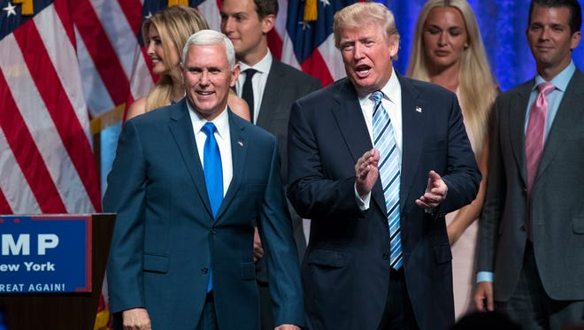 FILE PHOTO: Presidential candidate Donald Trump, right, introduces Gov. Mike Pence, R-Indiana.