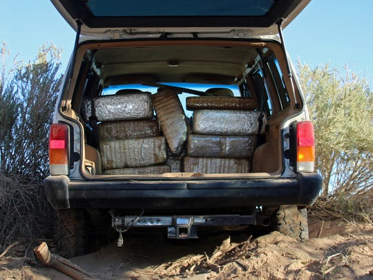 Border Patrol agents found drugs in the back of a vehicle.