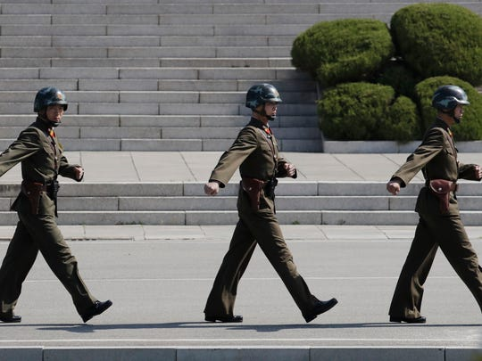 In this Wednesday, April 18, 2018 photo, North Korean soldiers march at the border village of Panmunjom in the Demilitarized Zone, South Korea. North Korean leader Kim Jong Un will meet South Korean President Moon Jae-in at the border village on April 27 for a rare summit that could prove significant in global efforts to resolve the decades-long standoff over the North's nuclear program.
