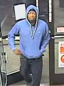The Circle K robber is described as a black male, 5 feet 10 inches to 6 feet tall, between 20 and 30 years old with a thin build, black hair, brown eyes and a goatee.