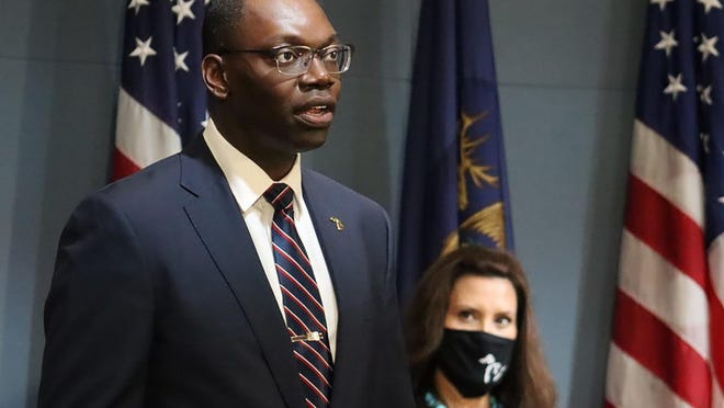 FILE - In this Sept. 10, 2020, file photo, provided by the Michigan Office of the Governor, Michigan Lt. Gov. Garlin Gilchrist II, accompanied by Gov. Gretchen Whitmer, right, speaks during an address to the state in Lansing, Mich. Lt. Gov. Gilchrist is calling for Republican legislative leaders to enact and enforce a mask requirement inside the House and Senate chambers. He said Wednesday, Oct. 7, 2020, he fears for the safety of his family and others when lawmakers do not wear a face covering. The Democrat presides over session in the Senate, which will return Thursday to start passing bills following a Michigan Supreme Court ruling that invalidated Gov. Gretchen Whitmer's coronavirus orders.