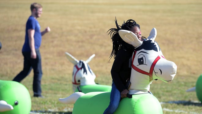 Nevaha Hyde rides an inflatable horse during Franklin's Family Day at the Park at Harlinsdale Farm on Nov. 5, 2016.
