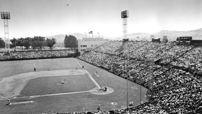 The San Francisco Giants play the Los Angeles Dodgers on opening day, April 15, 1958, at Seals Stadium in San Francisco.