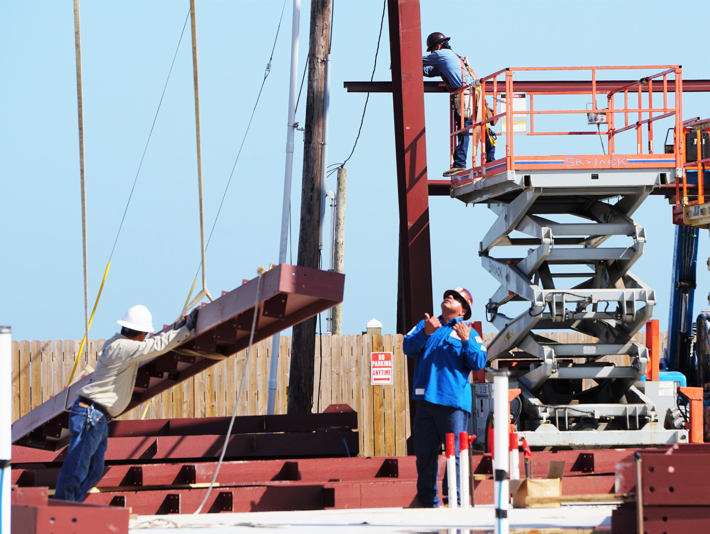 Construction crews work to erect steel in downtown