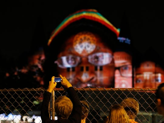 """Aaron Copland's """"Fanfare for the Common Man"""" plays as video portraits of Cincinnatians illuminate Music Hall in 2014."""