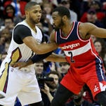 Washington Wizards guard John Wall (2) is defended by New Orleans Pelicans guard Eric Gordon (10) during the Wizards' 92-85 win at the Smoothie King Center Monday night.