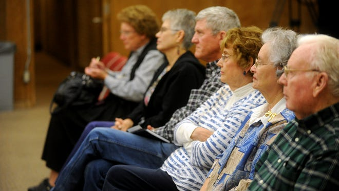 People attend a Texas Author Series talk at the main branch of the Abilene Public Library Monday, April 24, 2017.