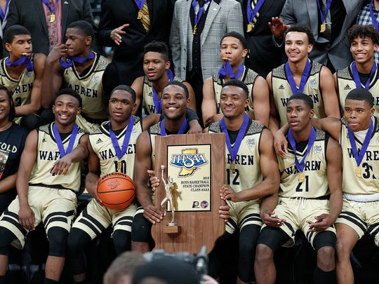 The Warren Central Warriors celebrate following the