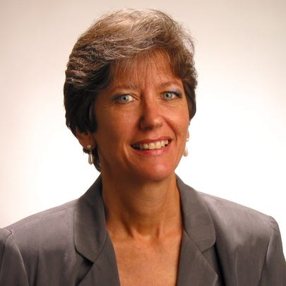 Kris Knab, retired  executive director of Legal Services