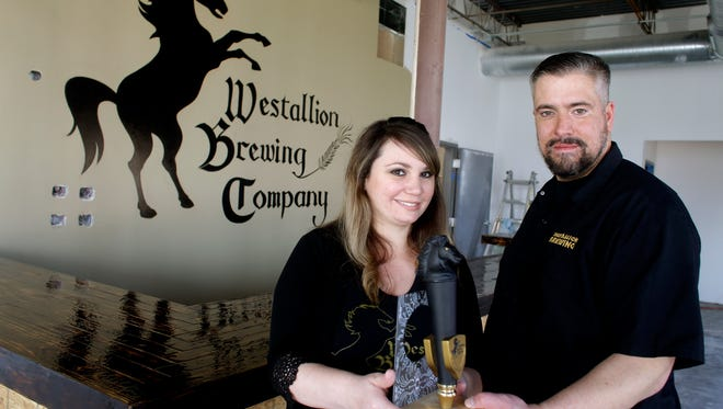 Kim and Erik Dorfner opened Westallion Brewing Co. in West Allis in 2017. The brewery is looking to be able to sell its beers in West Allis city parks.