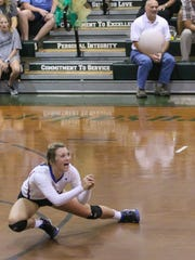 Pace's Livi Bradley (2) dives across the floor to return the ball against the Crusaders during senior night at Catholic High School on Thursday, October 12, 2017.