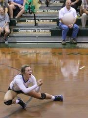 Pace's Livi Bradley (2) dives across the floor to return