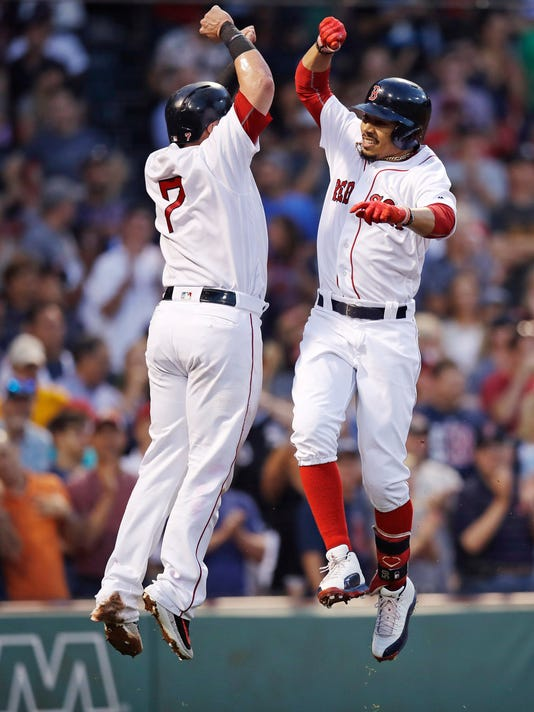 Boston Red Sox's Mookie Betts, right, celebrates with Xander Bogaerts after his two-run home run off Chicago White Sox starting pitcher Miguel Gonzalez during the second inning of a baseball game at Fenway Park, Thursday, Aug. 3, 2017, in Boston. (AP Photo/Charles Krupa)