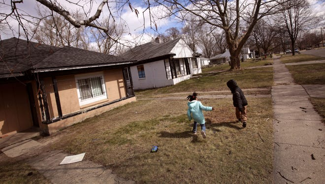 "Judyann Simpson, 6, left, and her cousin Alontae Bailey, 8 play outside the home her family has been renting for the past 3 years in the Brightmoor neighborhood in Detroit on Friday, March 10, 2017. Angela Simpson, 28 is planning on buying a home this year but is cautious about the process. ""I am looking longterm, I am trying to own my home but I don't want to be one of the ones who thought they owned a home and they didn't. They are a lot of scams out there,"" says Simpson."