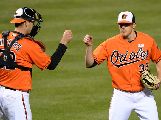Baltimore Orioles relief pitcher Brad Brach (35) celebrates