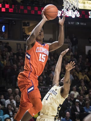 Clemson junior forward Donte Grantham shoots over defense from Wake Forest sophomore Keyshawn Woods.