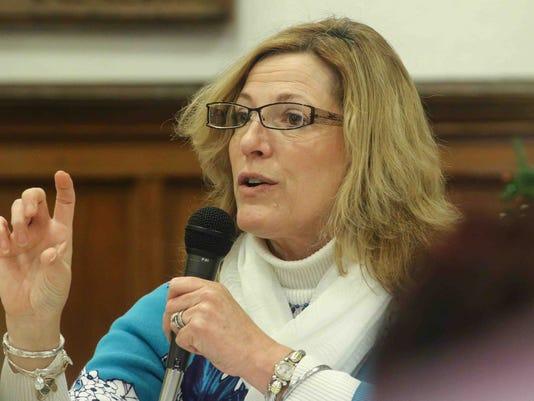 DHSS Secretary Rita Landgraf addresses members of audience during public hearing