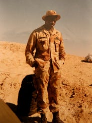 Sgt. Glen Coleman stands near his camp in Saudi Arabia