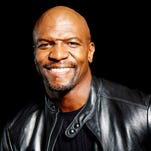 """Actor and former NFL player Terry Crews poses in New York on Sept. 19, 2013. Crews is replacing Cedric """"The Entertainer"""" as new host of the game show """"Who Wants To Be a Millionaire."""" The actor, former NFL player and Old Spice pitchman will join the weekday game show starting this fall, according to its studio, Disney-ABC Domestic Television."""