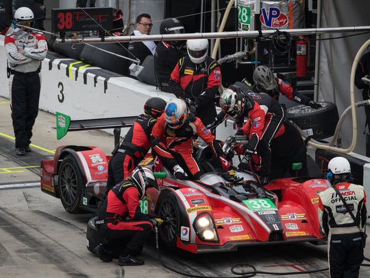 James French climbs out of the Performance Tech Motorsports ORECA FLM09 during a driver change in the Rolex 24 at Daytona sports-car race.