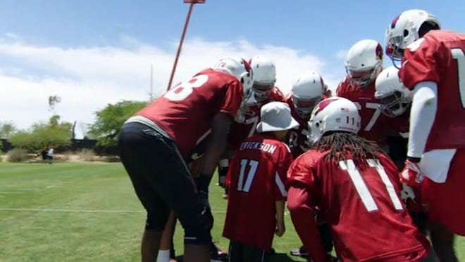 Tennyson Erickson, a Platte child, meets his football favorites, the Arizona Cardinals.