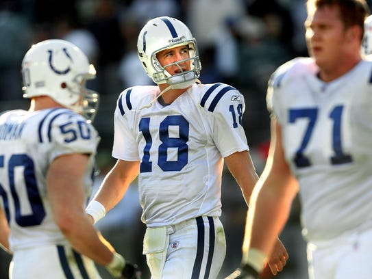Not much he could do: Peyton Manning looks on as the