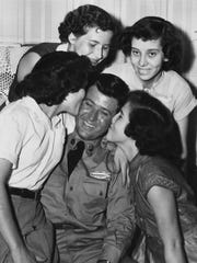 In a photograph published Sept. 6, 1953, Pvt. Lynn Howard (Shorty) Morgan, the first Knox County prisoner of war to be repatriated after the end of the Korean War, is welcomed home by his sisters, from left, Mary Ruth, Elizabeth, Barbara, and Dorothy. (News Sentinel Archive)