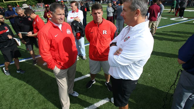 Ohio State defensive coordinator and former Rutgers Head Coach Greg Schiano, l,  Rutgers head football coach Chris Ash and Ohio State head coach Urban Meyer talk during the Rutgers Football Tri-state Showcase held on the campus of Fairleigh Dickinson University for high school recruits. June 8, 2016, Florham Park, NJ
