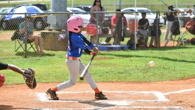 In this July 16 file photo, the Yigo Thunder's Hallee Derbai bats against the Yigo Astros during their Guam PONY Baseball League game at the Okkodo High School Field Complex in Dededo.