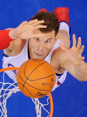Los Angeles Clippers forward Blake Griffin puts up a shot during the first half of their NBA basketball game against the Portland Trail Blazers, Friday, March 30, 2012, in Los Angeles.