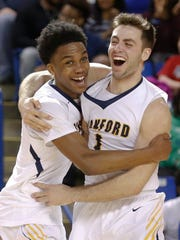 Sanford's Mikey Dixon (left) and Connor Rufo celebrate after the Warriors' 39-32 win in the DIAA state tournament Saturday at the Bob Carpenter Center.