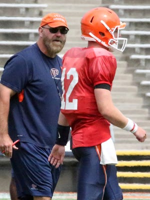 UTEP head football coach Sean Kugler talks with quarterback Ryan Metz during a practice.