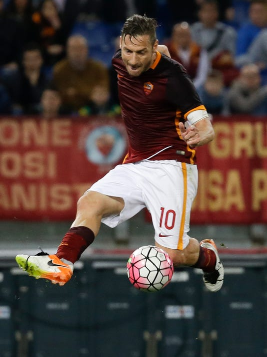 FILE - In this April 11, 2016 file photo Roma's Francesco Totti controls the ball during a Serie A soccer match between Roma and Bologna, in Rome's Olympic stadium. Totti has finally announced that the Sunday, May 28, 2017 match against Genoa will be his last with Roma after an incredible 25-season career with his hometown club. (AP Photo/Gregorio Borgia, file)