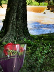 A bouquet of red roses had been placed at the base