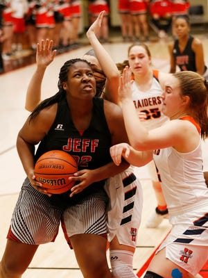 Destinee Cross of Lafayette Jeff works for a shot against Harrison in the girls basketball sectional Tuesday, January 30, 2018, at Logansport. Jeff defeated Harrison 63-52.