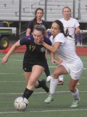 Norwalk junior Rachel Gavin tries to break free of