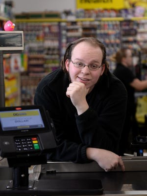 Lucas Holliday poses for a portrait on Tuesday, Nov. 15 at the Dollar General, 5640 S. Martin Luther King Blvd. in Lansing. A video of Holliday singing behind the cash register went viral.