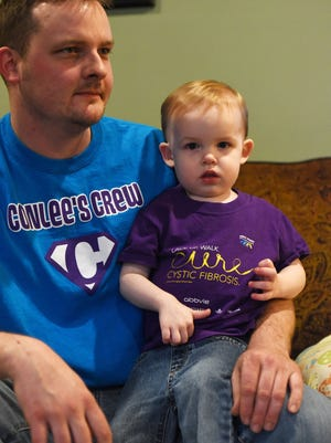 Conlee Handsy, 2, seen with his father Bryan, was born with cystic fibrosis. Without assistance from the Bureau of Children with Medical Handicaps, the family would not be able to afford medication and devices essential to Conlee's survival.
