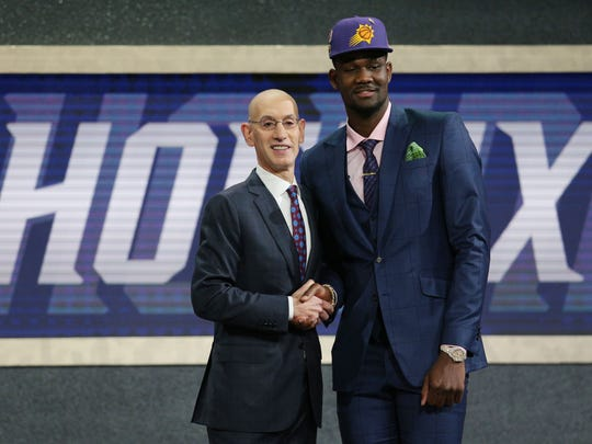 Deandre Ayton of Arizona greets NBA commissioner Adam Silver after being selected as the No. 1 overall pick by the Phoenix Suns in the 2018 NBA draft in Brooklyn.