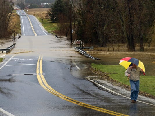 Brad Coe walks back to his house after checking on the Kreutz Creek. Coe who has lived along the creek 23 years said this flooding didn't compare in severity to historical floods. Paul Kuehnel -- Daily Record/Sunday News