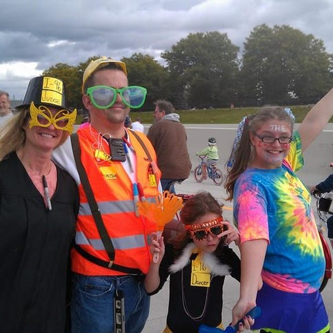 The Slomba family of Livonia came to the I-96 in costume. They all are looking forward to the freeway reopening tomorrow morning.
