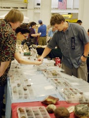 Patrons pick out stones for purchase from a vendor