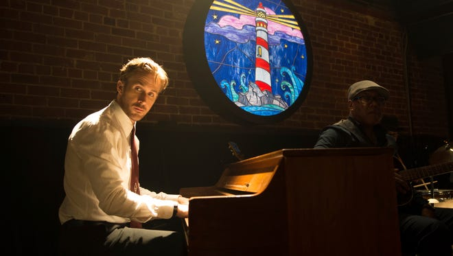 "Ryan Gosling is aspiring jazz pianist Sebastian in a scene from, ""La La Land."""