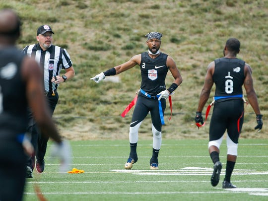 The Money Team's Anthony Webb yells after a play is called incorrectly during the Fighting Cancer vs The Money Team American Flag Football League game at Bud and Jackie Sellick Bowl on Saturday, July 14, 2018.