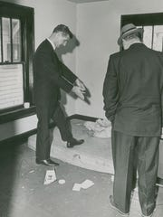 Deputy prosecutor Leroy New points to the the mattress where Sylvia Likens' body was found.