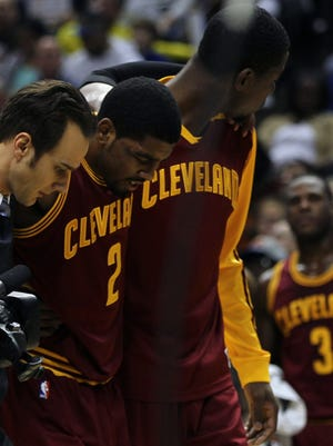 Cavaliers point guard Kyrie Irving was helped off the court Tuesday after bruising his knee against the Pacers.