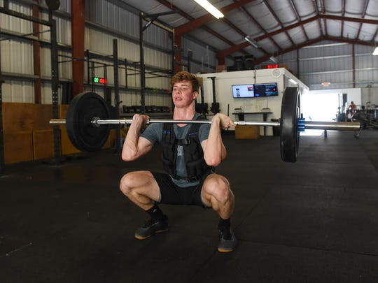 Ethan Elwel, 17, performs a front squat at Unified in Tamuning on July 3, 2018. Elwel is set to compete in the World Crossfit Games in Madison, Wisonsin on Aug. 1.