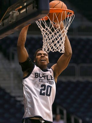 Butler guard Henry Baddley (20) goes for a dunk during practice at Hinkle Fieldhouse, Wednesday, October 26, 2016.